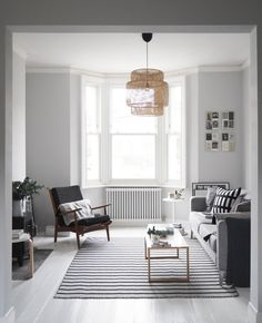 before and after living room makeover - light grey walls - painted white floors