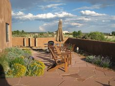 An adobe wall was constructed to enclose the patio.  The patio is made of Colorado flagstone and surrounded by lush plantings of perennials.  All of the plant