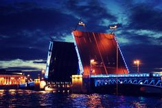 The most important highlight of the architectural delicacy in Saint Petersburg, Russia is considered to be the drawbridges. Soon they will be opened every night for a short period of time so ships may pass under the bridge. This show is considered the best spectacle in the city, which is remembered for a lifetime.  The best time to see t this show is during White Night in June. Explore St Petersburg city tours on ithorosho.com #vacation #travel #trip #travelling #world Petersburg Russia, Saint Petersburg, Vacation Travel, Marina Bay Sands, Highlight, Period, Travelling, Bridge, Saints