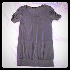 Blu heaven gray blouse Blue Heaven brand. Gray blouse, longer so can be worn with leggings. Ruching on the sleeves with button accents. Size medium. Blu Heaven Tops Blouses