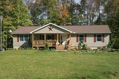 Ranch with pressure treated reverse gable porch Double Wide Remodel, Double Wide Home, Manufactured Home Porch, Porch Kits, Porch Ideas, Patio Ideas, Mobile Home Porch, Porches For Mobile Homes, Bungalow