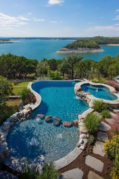 101 Swimming Pool Designs and Types (Photos) : This is a design that meshes the kiddie pool with the regular pool. A shallow end is marked off with large stones. This pool can easily be converted back to a normal pool when the children are older. Luxury Swimming Pools, Luxury Pools, Dream Pools, Backyard Pool Designs, Swimming Pool Designs, Pool Landscaping, Backyard Pools, Indoor Pools, Kiddie Pool