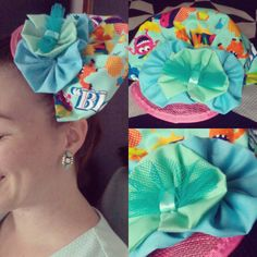 Week 13 of 52: Steal The Show // Crazy bam fabric gathered to a fan, upright style with pastel blue and green flowers finished with a mesh turquoise focal on a pink fascinator base. $60 + shipping.