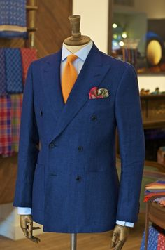 Navy Double Breasted linen jacket, orange cotton knitted tie, habotai silk paisley pocket square from Drakes