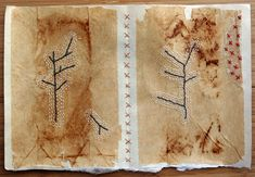 Page from The Book of Broken Branches hand stitched embroidery on teabags mounted on Japanese paper