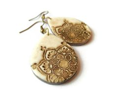 Lotus mandala earrings, faux ivory, aged bone carving, polymer clay teardrops, yoga jewelry. $17.00, via Etsy.