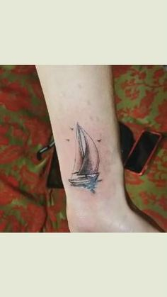 "My sailboat tattoo! ""When the wind didn't blow her way, she adjusted her sails and headed for clear skies."""