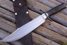 Maple Bowie.Forged blade with temper line.Blued steel fittings.Nickel silver spacers. Blackwood handle carved with a maple leaf on each side.