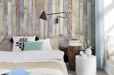 Want to create a feature wall? This vintage mural has a trompe l'oueil effect, an illusion that your wall is paneled in rustic wood. Chic distresses of green an