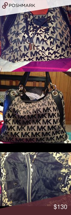A beautiful MK bag! Black and Tan bag, medium size with leather trimming. Excellent condition, just don't carry it much! Michael Kors Bags Hobos