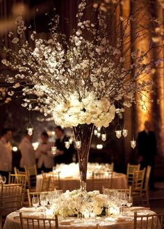 Take a look at the best wedding centerpieces with candles and flowers in the photos below and get ideas for your wedding flowers! All-white flowers, branches, and hanging candles create a stunning winter centerpiece. Rustic Wedding Centerpieces, Wedding Table, Fall Wedding, Wedding Reception, Dream Wedding, Centerpiece Ideas, Tall Centerpiece, Wedding Blog, Floral Centerpieces