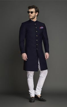 Navy Blue Achkan is a staple and a smart ceremonial color and you can never go wrong with it. Mens Wedding Wear Indian, Indian Wedding Clothes For Men, Sherwani For Men Wedding, Mens Indian Wear, Mens Ethnic Wear, Indian Groom Wear, Wedding Dress Men, Indian Men Fashion, Men's Wedding Wear