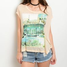 City Name Graphic Tee Graphic Tee with City Names London, New York, Paris & Milan  🌺 Peach color, lightweight 100% Polyester knit 🌺 Pretty city landscape scenes on front of top 🌺 Relaxed fit, short sleeves and rounded neck Beach Wave Tops Tees - Short Sleeve