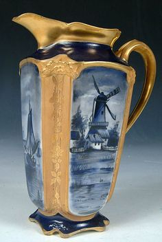 A VERY FINE CHICAGO STUDIO DECORATED CHOCOLATE POT WITH FOUR PANEL WINDMILL SCENES WITHIN ETCHED GOLD BORDERS ON LIMOGES BLANK