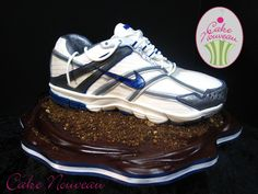 Cake : blue and white Nike running shoe ... stitching detail is amazing!! By Cake Nouveau