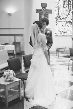Catholic Church Summer Wedding   Wedding Ceremony   Bride and groom first kiss