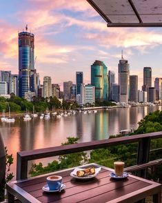 """Visit Brisbane on Instagram: """"No one's awake 'til they've had that first sip of pure caffeine right? So technically, you'd be waking up to this gorgeous sunrise view…"""" Brisbane Cbd, Caffeine, Marina Bay Sands, Wake Up, Skyscraper, Sunrise, Skyline, Australia, Pure Products"""