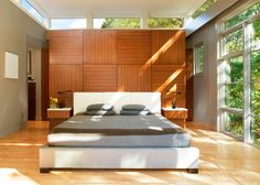 Sunny, modern California Zen (except it happens to be in D.C.). This simple and uncluttered room is made cheerful with sunlight and warm wood.
