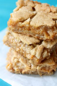 Ooey Gooey Dulce de Leche Cookie Bars: 2 rolls (16.5 oz each) Pillsbury® refrigerated sugar cookie dough; 1 cup quick cooking oats; 1 cup packed brown sugar; 1 bag (14 oz) caramels, unwrapped; 1/2 cup butter; 1 can (14 oz) sweetened condensed milk
