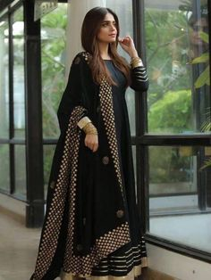 Buy Latest Indian Designer Wedding Anarkali Suit. The Anarkali suit is made up of a long, frock-style top and features a slim fitted bottom. The Anarkali suit varies in many different lengths and embroideries including floor-length Anarkali styles. Bollywood AnarkalisinTrend#anarkalisuits#latest#designed#georgette#black Pakistani Dresses Casual, Indian Gowns Dresses, Pakistani Dress Design, Flapper Dresses, Black Anarkali, Anarkali Dress, Long Anarkali, Designer Anarkali, Lehenga Designs