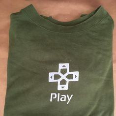 Retro PlayStation 2 Play tee , khaki green   Size:S/XS, Style:regular Colour:Green,olive green , khaki. Condition: 7/10 some pulls to fabric not a surprise given the age of the item  Can post tomorrow   @depop  #gamer #retro #gamesconsole #holiday #gamescube #atari #urbanoutfittets #ps2 #logo #xbox #vintage #nintendo #controller #summer #sale #collector #crashbandicoot #spyro #sega #game #phone #apple #wii #gta #playstation4 #cosplay #kawaii #popular #alternative vintage, retro, wom...