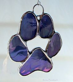 Powercat paw print in purple stained glass.