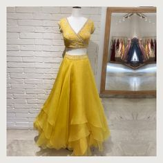 A synergy of colours from the Discover our layered Organza Skirt paired with a chic wrap around blouse 💛 . Party Wear Indian Dresses, Indian Gowns Dresses, Indian Bridal Outfits, Indian Fashion Dresses, Dress Indian Style, Indian Designer Outfits, Designer Dresses, Lehenga Choli, Blouse Lehenga