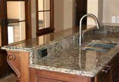 New on the market ... a cheap & simple no-paint film to make countertops look like granite.