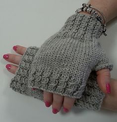 Ravelry: Twisted Rib Fingerless Gloves pattern by Jane Terzza