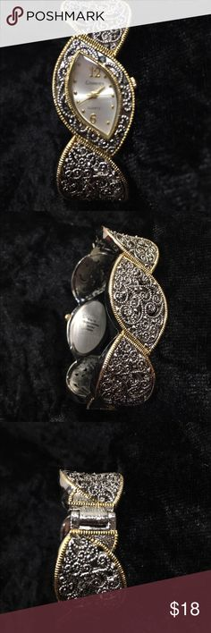 Silver and Gold Tone Hinged Watch Stunning hinged watched! It is a hinged bracelet style and even has tiny little black rhinestones. I purchased this new and only wore it twice before leaving the corporate world. Smoke free, pet friendly. Thank you for looking! Accessories Watches