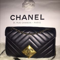 CHANEL BAG AUTHENTIC CHANEL lamb skin cross body bag. Purchased at 31, RUE CAMBON - PARIS. It's in perfect condition, I've worn it twice. I'd like to sell this one so I can get a bigger one.  Black exterior with a beautiful burgundy interior. I have the original box it came with, as well as the dust bag and glove to clean it. Authenticity card displayed on photos. NO TRADES. NO LOW BALLING. SERIOUS INQUIRIES ONLY.  And YES, it is 100% AUTHENTIC.  CHANEL Bags Crossbody Bags