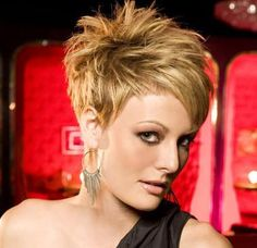 Asymmetrical Haircuts for Older Women | Highlighted short blonde hairstyle with side swept bangs.