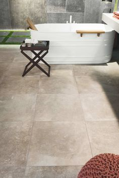 Lovely Bruges Beige porcelain tiles used in a stylish bathroom very practical and hard wearing