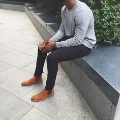 Sleek + formal yet casual. Pairing neutral colors creates an instant classic modernist look. Grey crewneck sweater, black or even a navy blue slim fitted chinos or trousers + brown or beige Chelsea boots.