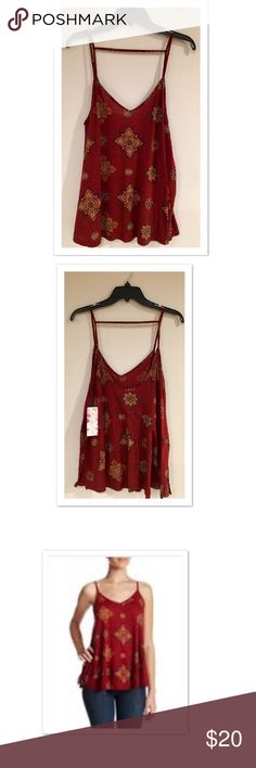 """Wild Pearl Trapeze Linen/Rayon Tank Top Floral/Geo print trapeze top by Wild Pearl. Linen/Rayon. Wide/Trapeze fit measures approx 21"""" across Underarms. Approx 27"""" length. Burgundy. Purple. Gold. Side slits as shown in pic. Single bar strap across upper back. Wild Pearl Tops Tank Tops"""