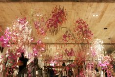 wire and flower mobiles/chandeliers in the Free People Store on Walnut Street, Philadelphia | via fp blog