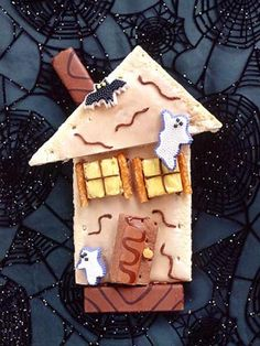 Build this not-so-scary haunted house with toaster pastries, fudge-stick cookies, mini pretzel sticks, graham crackers, decorating gel, yellow frosting and petite Halloween candies. Use frosting to attach roof to house and to secure decorations.
