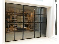 From Glass At Work: Black Framed Industrial Factory Style Glass Partition Wall & Door for a Domestic Project in Fulham, London. Glass Partition Designs, Glass Partition Wall, Glass Design, Partition Ideas, Crittal Doors, Glass Balcony, Balcony Door, Lounge, Bars For Home