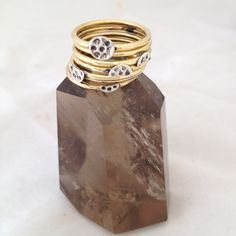 Luna stack. moon phase stack ring with sterling silver moon base and brass ring sitting on smokey quartz.