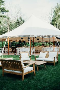 Outdoor summer reception - tent, blue Chinese lanterns, white patio furniture. Willowdale Estate, a weddings and events venue in New England. WillowdaleEstate.com | Erica Ferrone Photography