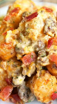 Bacon Cheeseburger Tater Tot Casserole ~ Hamburger, bacon, cheese, cheese soup, sour cream and tater tots... Soooo good!