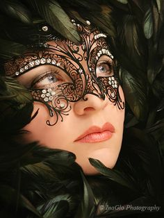 Black filagree metal crystal embellished feather Masquerade Mask. this is pretty with the rhinestones