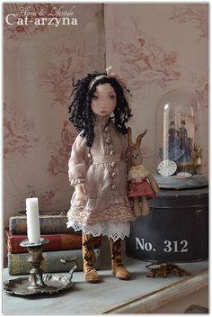 brunette cloth doll.
