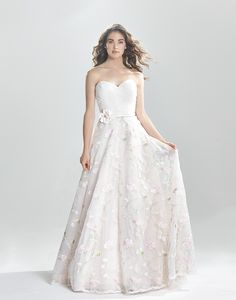 Lillian West Style 6391 - Sweetheart ruched bodice, natural waistline with flower adorned belt and all over colored floral embroidered organza skirt create a whimsical and romantic wedding day look.