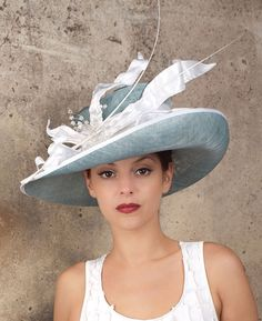 Tennis | Label: Vivien Sheriff | Spring/Summer 2012 | Classic up brim hat with dramatic free-standing silk petal trim finished with a centre piece of wired Swarovski crystal cubes and two quills