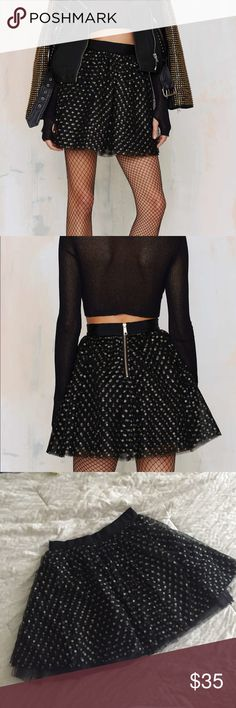 "XS Wanna Have Fun Polka Dot tulle skirt NWOT Black tulle skirt with gold, sparkly polka dots. Gold zipper up back. Lined on the inside.   By Nasty Gal  Brand new without tags  Length is approximately 16.5"" Nasty Gal Skirts A-Line or Full"