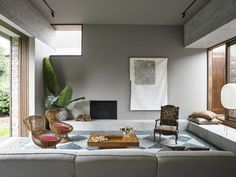 Living Room, Chair, Ceiling An Addition to a 1940s Home in Sydney Amplifies Its Connection to the Outdoors #dwell #homeaddition #australia #moderndesign Isamu Noguchi, Garden Living, Home And Garden, Living Area, Living Spaces, 1940s Home, Recycled Brick, Terrazo, Timber Windows