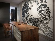 A 14-foot vermillion painting by Carlos Capelan adds a gorgeous element to Andaz 5th Avenue's lounge. #NYC #bar #art