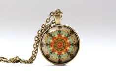 Comes in a bronze or silver finish. Cool colorful pendant. Lovely Buddhist necklace with a chain or a leather cord. Nice hippie jewelry. SIZE: 25 mm