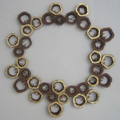 Evelien Sipkes  Necklace. Mahogany, hemp, gold leaf.